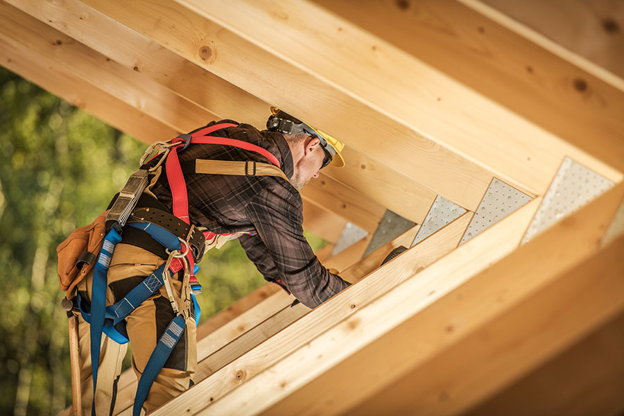 Specialized Business Insurance - View of Contractor Working on Framing New Home
